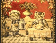 Two cats serving tea, woven in a rug