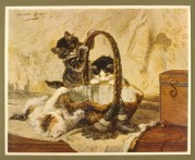 Three kittens play with a basket