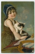 A girl carries her cat to a chair