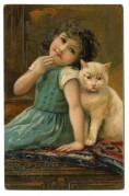 A girl and her cat pose on a cushion