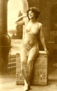 Naked Model Poses on Decorated Trunk