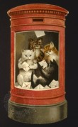 Kittens in a post box reading Christmas letters