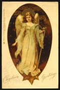 Angel and harp on a Christmas card