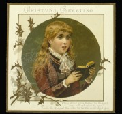 A boy reads a Christmas greeting